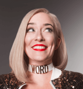 """Hillary wears red lipstick and a choker with """"WORD"""" on, smiling"""